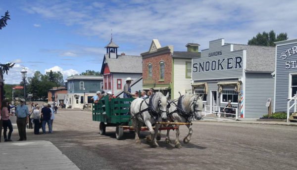 A horse drawn cart at Heritage Park, a Calgary airport limo featured destination